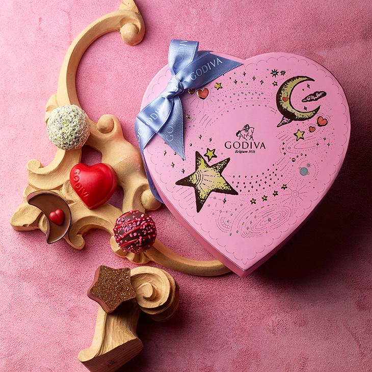 ゴディバ きらめく夜空を表現したハート形のパッケージに、星、月、ハート形の限定チョコレートを詰め合わせました。 ●きらめく想い ハート 価格:3,240円(6粒入)